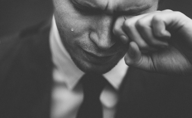 man in suit crying funny recruitment flight centre jobs tear rolling down his face