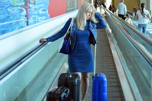 airlines weigh passengers woman in airport looking sad and tired with baggage