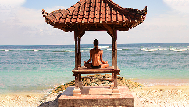 womaan-under-beach-pagoda-does-yoga