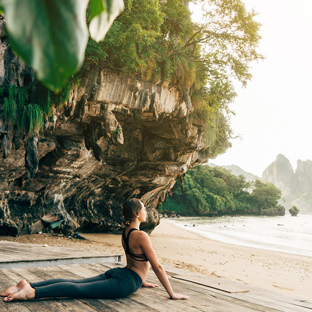 wellness travel yoga on the beach