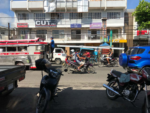 jeepney and tricycle traffic in pili camarines sur bicol philippines
