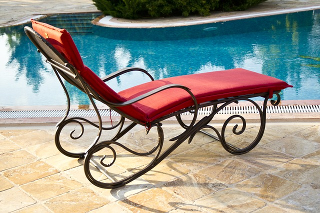one red lounge chair by pool on a resort for single parent vacations