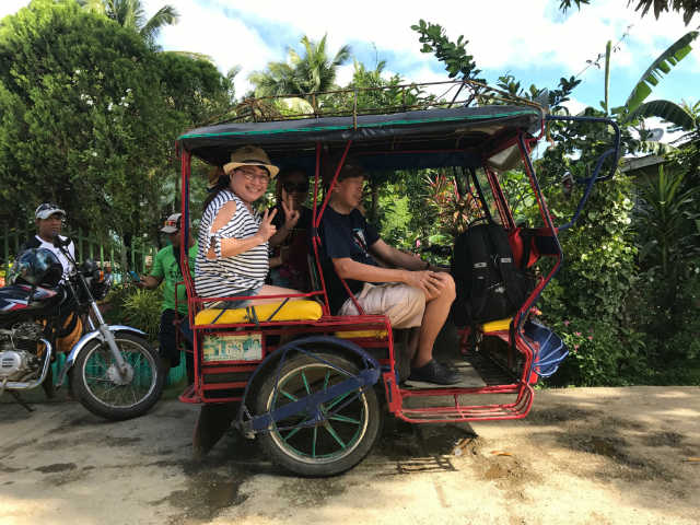 tricycle and motorcycle riders in caramoan bicol philippines islands