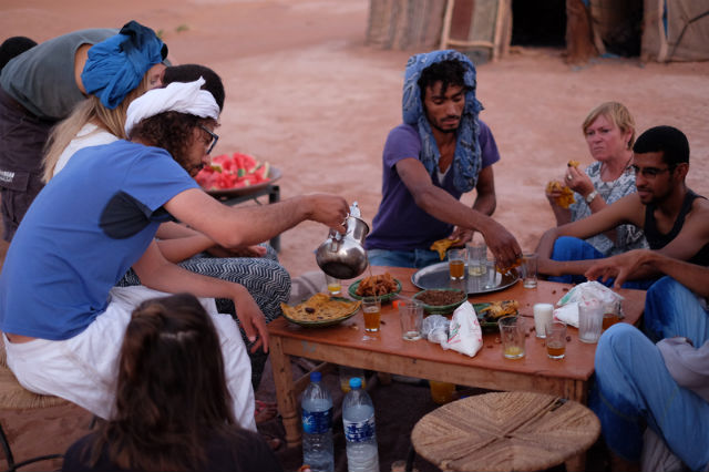 men and women sharing a meal in morocco