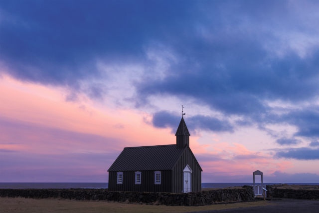 budir church at dusk in iceland