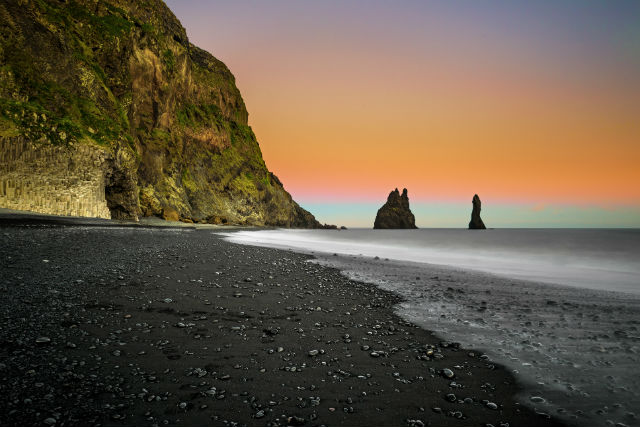 black sand on the reynisfjara beach in iceland