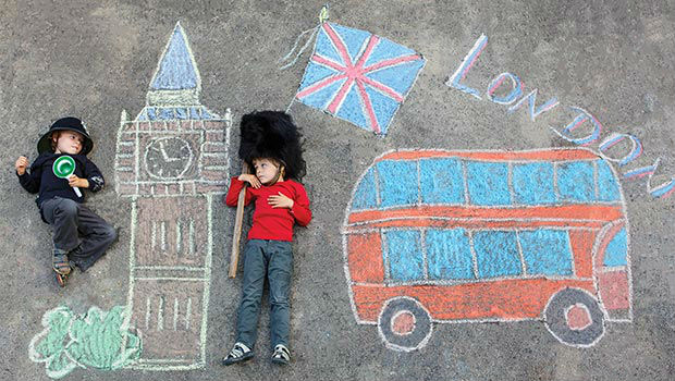 kids next to chalk drawings of london