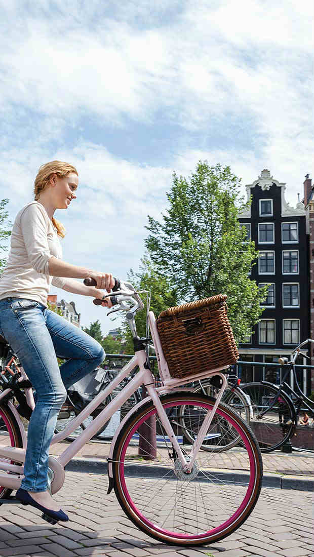 woman on a bicycle in amsterdam