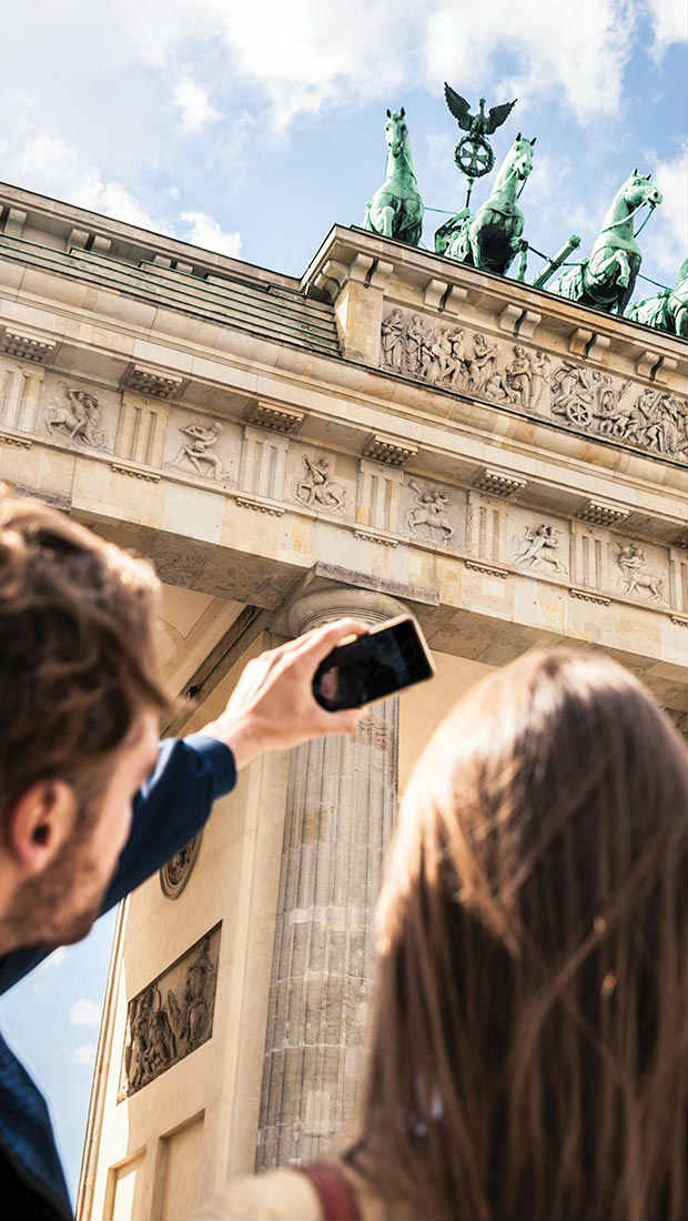 man and woman taking a selfie in berlin germany