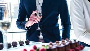 business-traveller-drinking-champagne-in-business-class-lounge