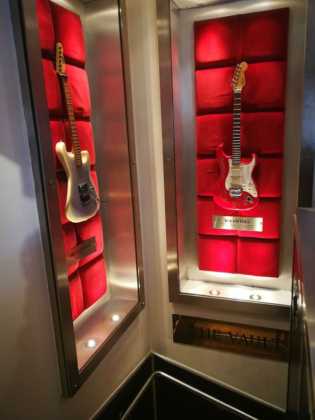 sex-pistols-guitar-points-down-into-the -london-hard-rock-music-museum-the-vault
