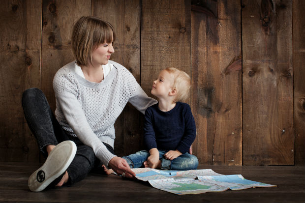 mom with child looking at map