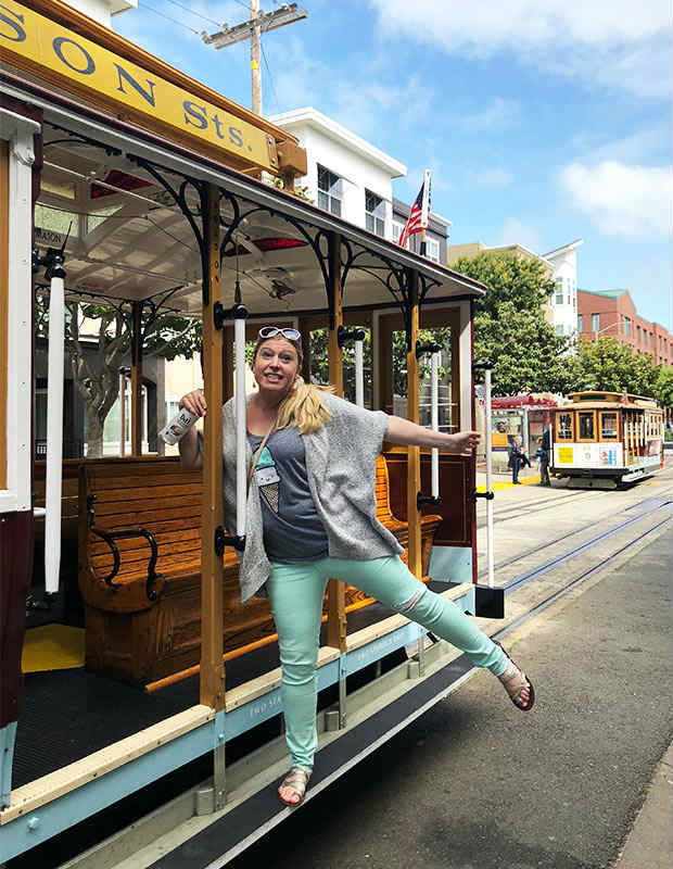 woman on cable car in san francisco