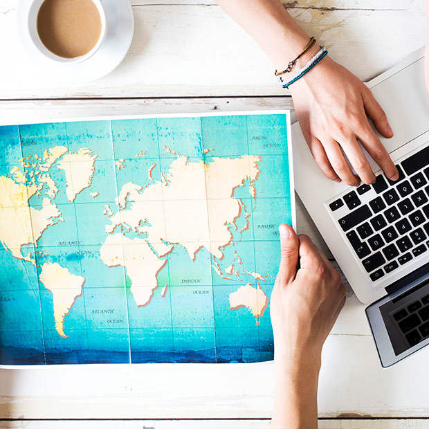 map and computer open to book travel