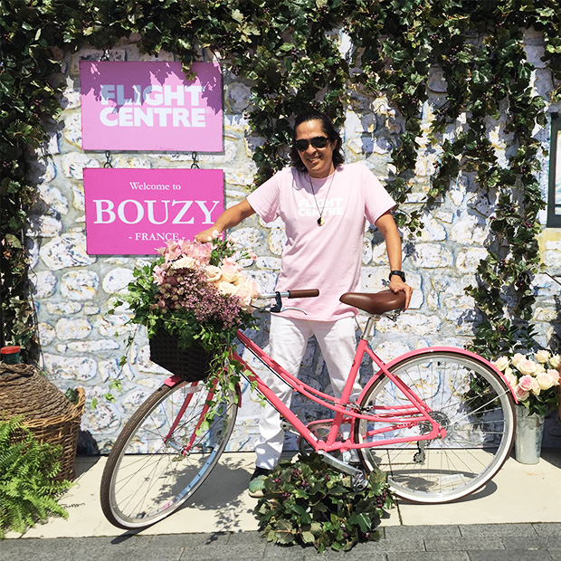 man holding a pink bicycle