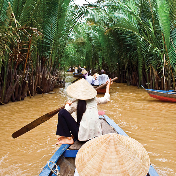 travellers guided down a river in a boat