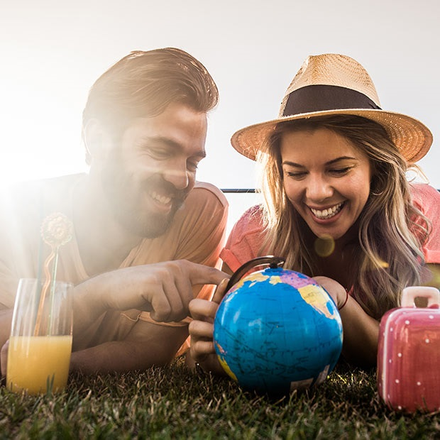 How to Plan a Trip to Europe - Two people in front of a globe