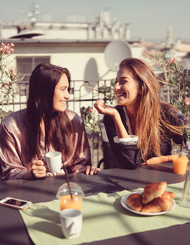 Things to Do in Paris - Two young ladies smiling and talking