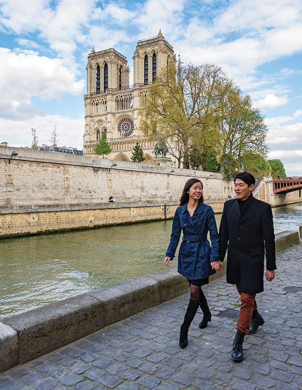 Things to Do in Paris - Couple taking a walk near a river