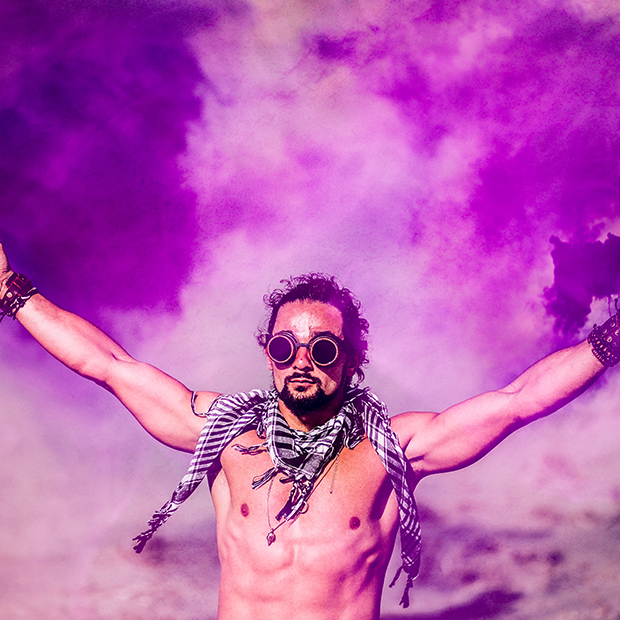 man in goggles in front of purple dust