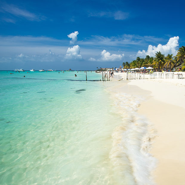 white sand and blue water in isla mujeres