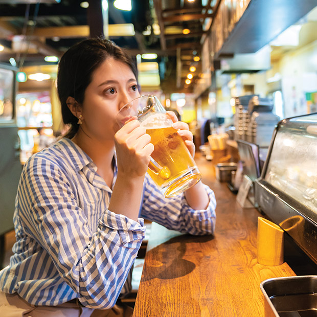 osaka-attractions-young-woman-sips-beer-at-restaurant-japan-festivals