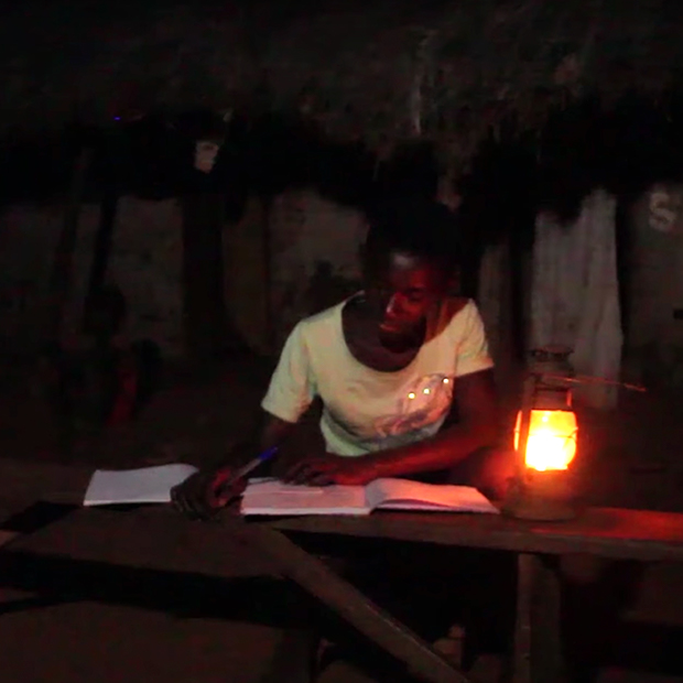 african-student-reads-by-kerosene-lamp