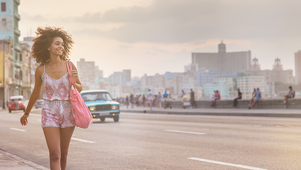 woman walking down el malecon in cuba