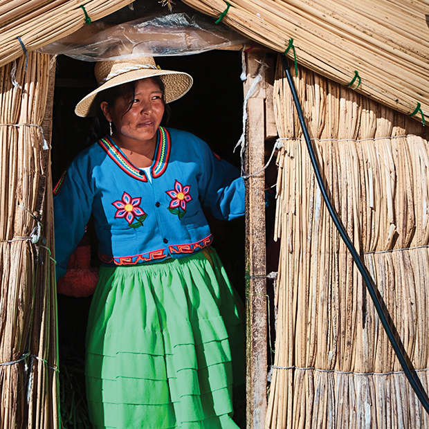 woman in a house in lake titicaca peru