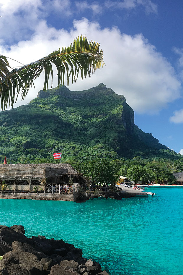 view of vaitape town and mount otemanu in bora bora