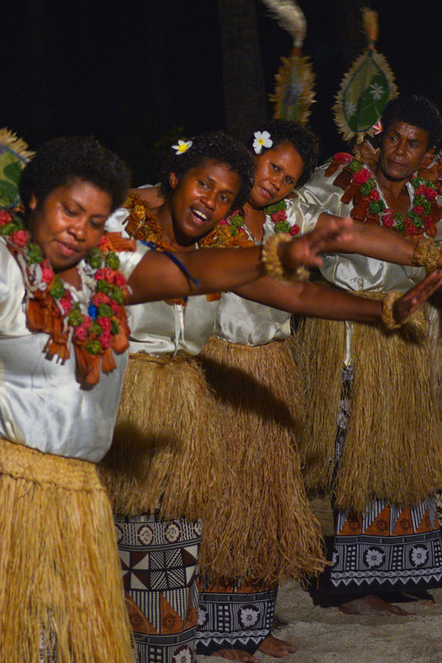 women dancing in traditional polynesian outfits