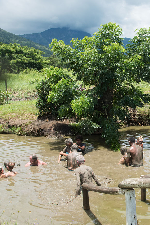 people covered in mud in fiji