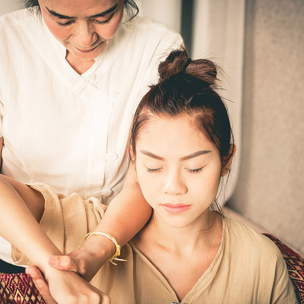 traditional-balinese-healer-helps-young-woman-with-eyes-closed