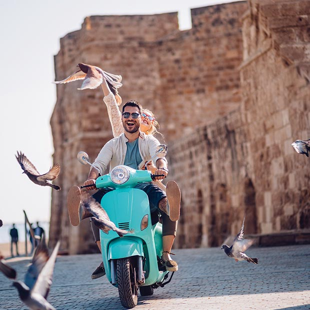 couple on a scooter in italy