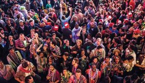 mardi-gras-celebrations-around-the-world-large-colourful-group-in-new-orleans-aerial-view