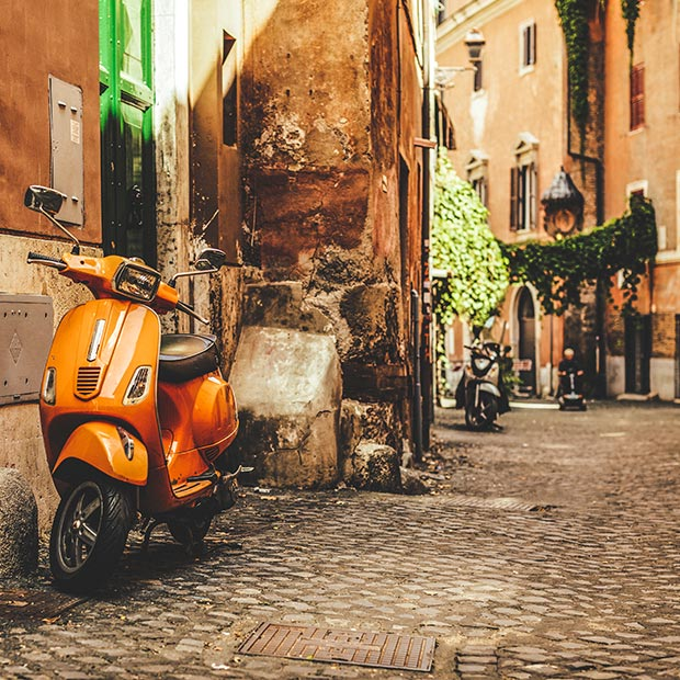 scooter on a cobblestone road in rome