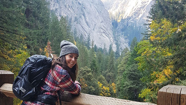 smiling-female-wears-plaid-shirt-grey-toque-in-switzerland-in-the-alps