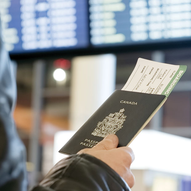flight centre business travel man holds canadian passport at airport