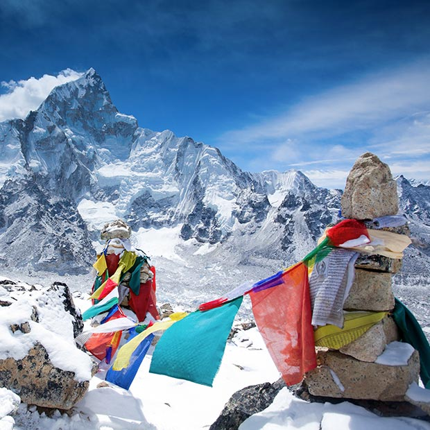 prayer flags on the summit of mount everest in nepal