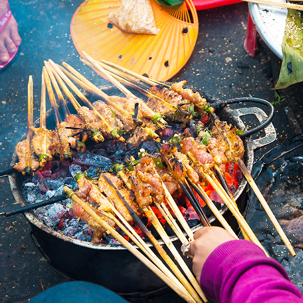 skewers over a grill in vietnam