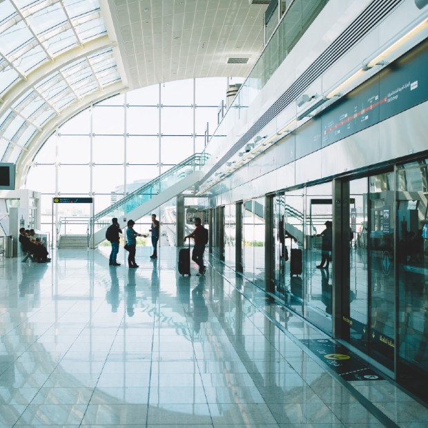 business travellers standing beside a window in an airport