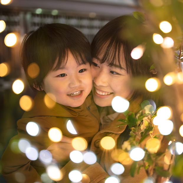 a woman and a child look at holiday lights together during Ōmisoka in japan