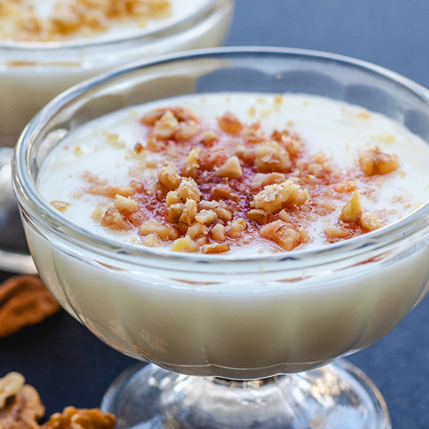 Glass of Middle Eastern holiday Beverage Sahlab topped with nuts