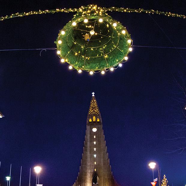 illuminated cathedral bell tower at reykjavik christmas market
