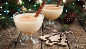 Two festive holiday beverages with cinnamon stick garnish