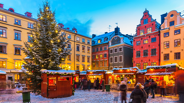 people explore a christmas market in sweden