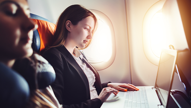 business woman works on her laptop during a flight