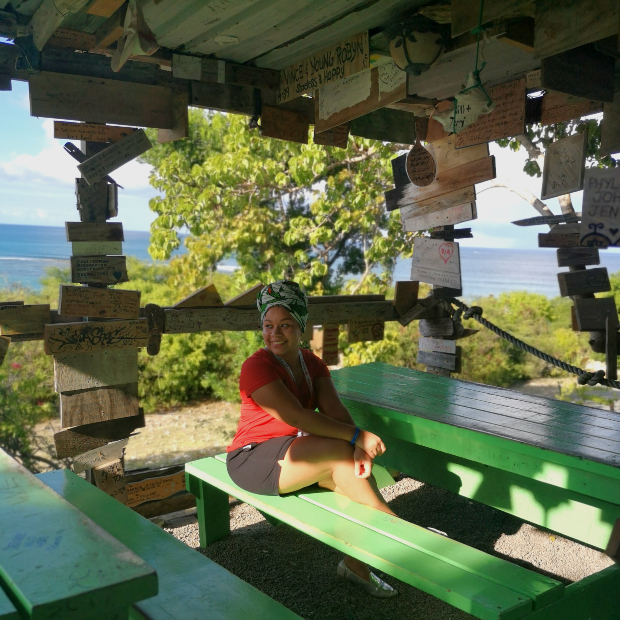 traveller smiles while seated at a table in outhouse pineapple beach