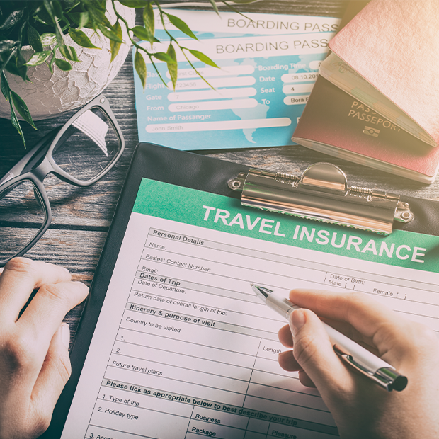 a traveller fills out a travel insurance form