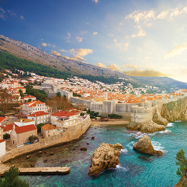 view of red roofed buildings in dubrovnik croatia from the sea